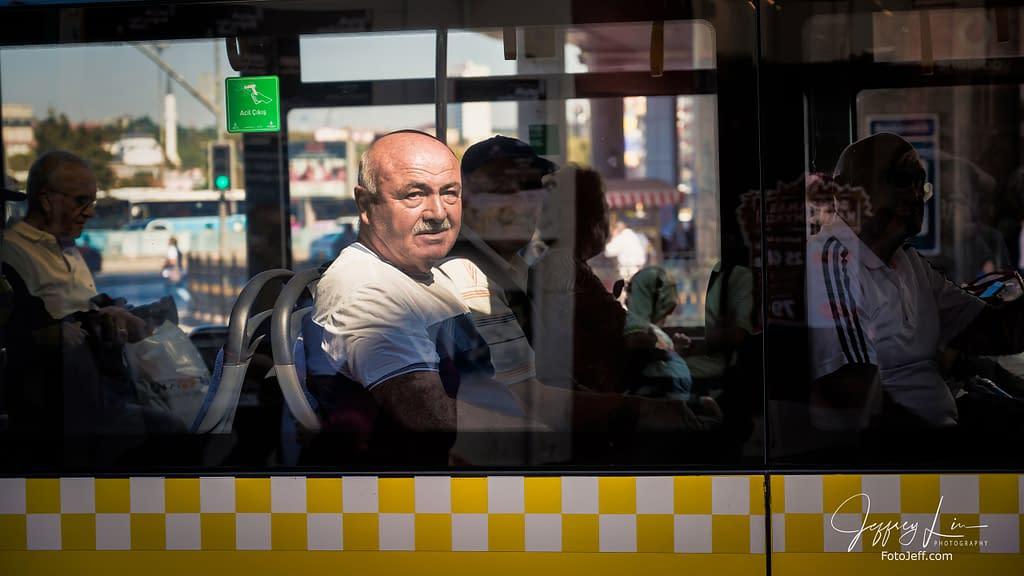 20. Looking Through Bus Window