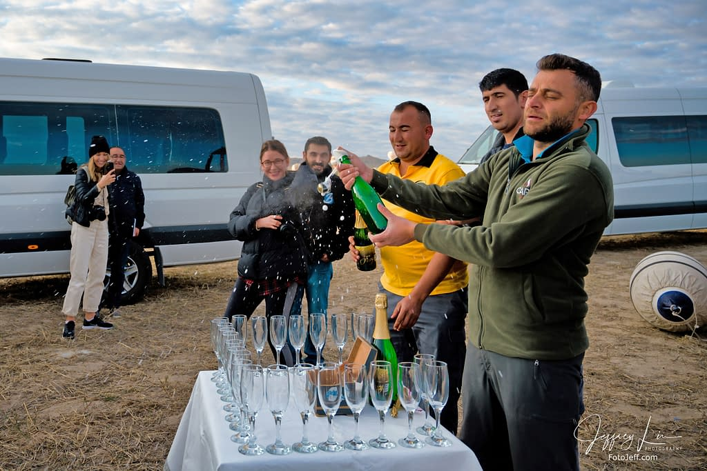 39. 7:16 am - Champagne Toast After the Flight (Our Pilot is Holding the Bottle)